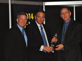 Henkel's Michael Pierce (far left) and Dr. Dwight Heinrich (far right) are presented with the Global Technology Award from Trevor Galbraith (center), Publisher of Global SMT and Packaging magazine.