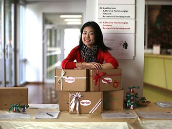 "Lucy Zhang with ""Boxes of Love"" which have already been packed and which are to be sent to children in need all over China for the Chinese New Year."