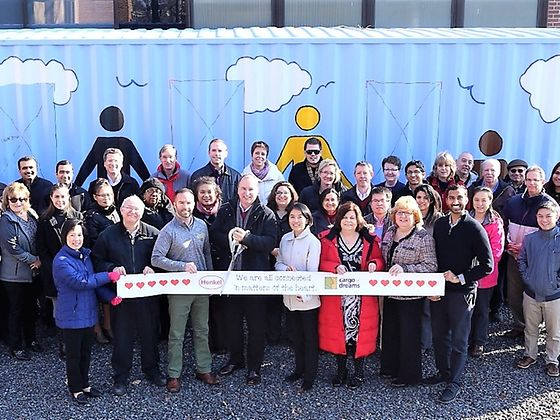 Bridgewater employees celebrate the completion of the Cargo of Dreams construction