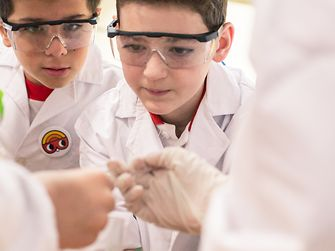 In Argentina, the children are fully concentrated on their experiment.