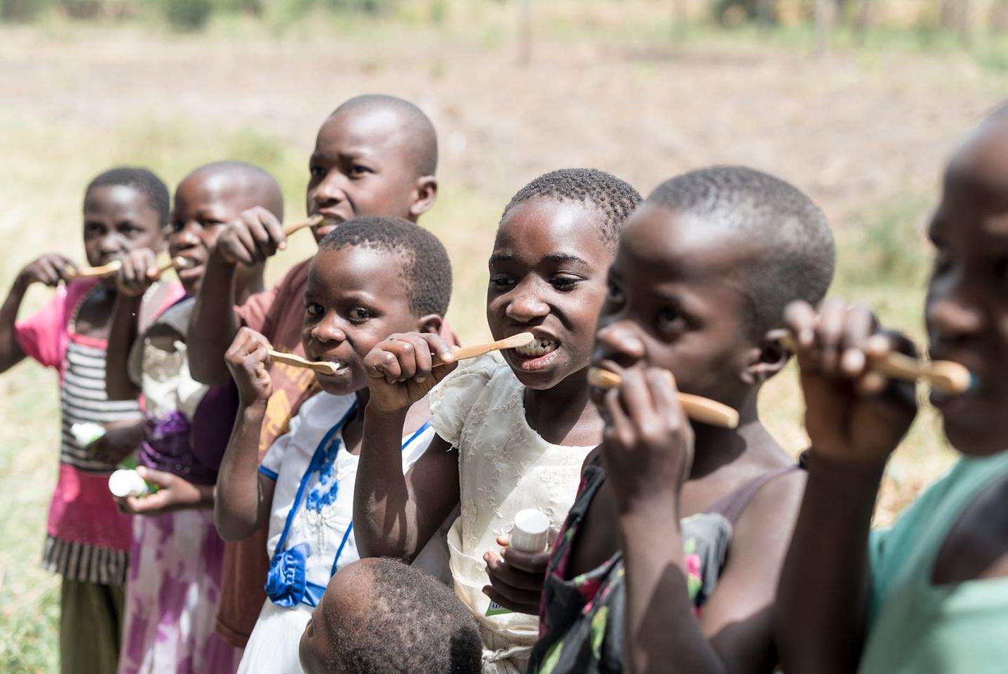 Children and their caregivers learn the right techniques for brushing their teeth